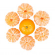 Stock Photo: Six peeled mandarins and one unbroken one isolated