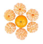 Six peeled mandarins and one unbroken one isolated — Stock Photo