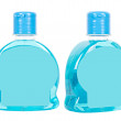 Blue bottles with liquid soap — Stock Photo