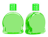 Green bottles with liquid soap — Stock Photo