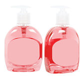 Red bottles with liquid soap — Stock Photo