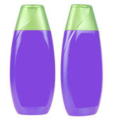 Blue shampoo bottles with violet caps — Стоковое фото