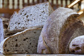 Eco-friendly products on the market stall. Slices of rye bread — Stock Photo
