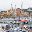 France , Menton, 15 October 2013 . The typical tourist sight : the old town and the port with moored yachts. — 图库照片