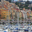 France , Menton, 15 October 2013 . The typical tourist sight : the old town and the port with moored yachts. — Foto de Stock