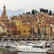 France , Menton, 15 October 2013 . The typical tourist sight : the old town and the port with moored yachts. — Stok fotoğraf