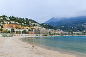 France , Cote d'Azur , Menton. View of the coast of the bay , the Alps and coastal hotels . foggy weather — Stock Photo