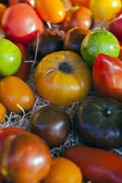 Eco-friendly products on the market stall. Different varieties of tomatoes — Stock Photo