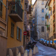 France , Cote d'Azur . Nice, narrow street of the old town , and you men late in the season — Stock Photo