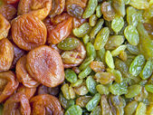 Background of dried fruits , raisins and dried apricots — Stock Photo