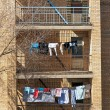 View from the window on the wall of apartment building with balconies — Stock Photo