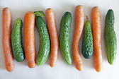 Fresh vegetables for salad , cucumbers and carrots — Stock Photo