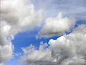 Heavenly landscape: clouds on a bright blue sky — Stock Photo