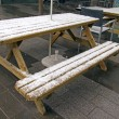 Постер, плакат: Berlin a blizzard in the last days of winter Outdoor cafe tables covered with snow