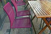 Berlin , a blizzard in the last days of winter . Outdoor cafe tables , covered with snow — Stock Photo