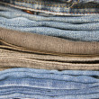 Stack of jeans in various shades — Stock Photo
