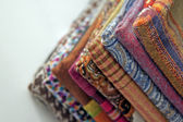 Stack of colorful scarves on the counter — Stock Photo