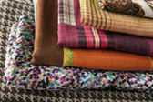 Stack of colorful scarves on the counter — Foto de Stock