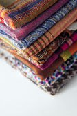 Stack of colorful scarves on the counter — Стоковое фото