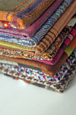 Stack of colorful scarves on the counter — Stock fotografie