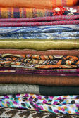 Stack of colorful scarves on the counter — Zdjęcie stockowe