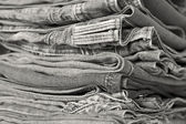 Stack of jeans in various shades — Zdjęcie stockowe