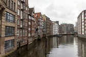 Hamburg, Germany , February 19, 2013. View of the old houses on the banks of the Alster river channels on a cloudy winter day. — Stock Photo