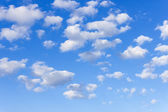 Light white clouds in the blue sky — Stock Photo