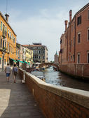 Venice, Italy, June 20, 2012 . Typical city street - view channel — Stock Photo