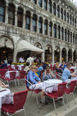 Venice, Italy, June 20, 2012 . Tourists sit in a cafe on the Piazza San Marco summer hot day — Stock Photo