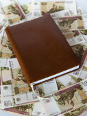 Brown weekly on background of Russian banknotes — Stock Photo