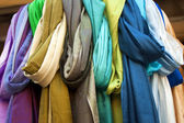 Colorful scarves on display in store — Stock Photo