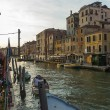 Venice, Italy, June 24, 2012 . Kind of a Venetian canal in the early evening . Tourists rest in a cafe on the shore — Stock Photo #40545261