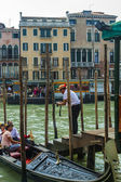 Venice, Italy, June 25, 2012 . Gondolier photographing tourists at their request — Stock Photo