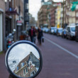 Amsterdam, The Netherlands. View of the typical city street overcast spring day — Stock Photo #40959679