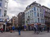 Amsterdam, The Netherlands. View of the typical city street overcast spring day — Stockfoto
