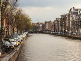 Amsterdam, The Netherlands, April 12, 2012 . Canal in the central part of the city — Stock Photo