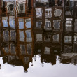 Amsterdam, The Netherlands, April 13, 2012 . Houses on the canal reflected in its water — Stock Photo #41045453