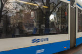 Amsterdam, The Netherlands, April 15, 2012 . Tram on city street — Stock Photo