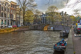 Amsterdam, The Netherlands, April 14, 2012 . Bridge over a canal in the city center — Stock Photo