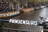 Amsterdam, Holland. old bridge railing with his name — ストック写真