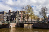 Amsterdam, Holland. Old bridge over a canal in the city center — Stock Photo