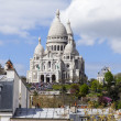Paris, France, on April 29, 2013. View of Montmartre and cathedral Sakre-Ker from a house window in the sunny spring afternoon — Stock Photo #42797533