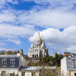 Paris, France, on April 29, 2013. View of Montmartre and cathedral Sakre-Ker from a house window in the sunny spring afternoon — Stock Photo #42797543