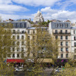 Paris, France, on April 29, 2013. View of Montmartre and cathedral Sakre-Ker from a house window in the sunny spring afternoon — Stock Photo