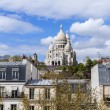 Paris, France, on April 29, 2013. View of Montmartre and cathedral Sakre-Ker from a house window in the sunny spring afternoon — Stock Photo #42797585