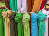 Scarves in various shades of the storefront — Stock Photo