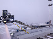 Moscow, Russia. Plane processing by anti-freezing means at the airport — Stock Photo