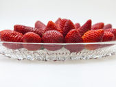 Large ripe strawberry berries on a large platter — Stock Photo