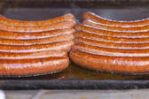 Budapest, Hungary, Fair. Hungarian sausages fried in a pan in the outdoor cafes — Stock Photo